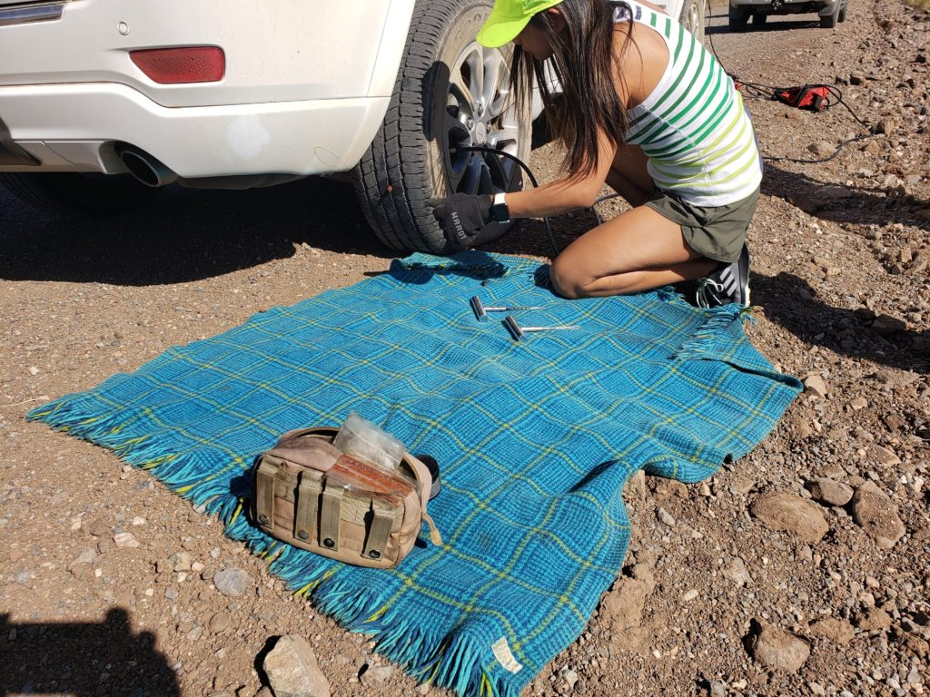 extreme outback kit used by female to plug a tire leak